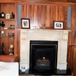 Solid Walnut panelling and bookcases